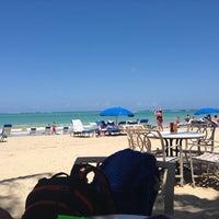 Photo taken at Isla Verde Beach - Balneario Isla Verde (La Playa) by Hugo B. on 4/2/2014