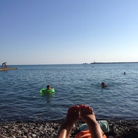Photo taken at Пляж Мориса Тореза by Zlatka A. on 7/24/2014