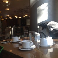 Photo taken at Merlin Cafe by Kiki A. on 12/15/2013