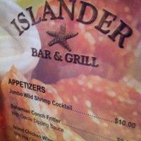 Photo taken at Islander Bar & Grill by Toninho T. on 5/19/2013