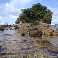 Photo taken at Playa La Caleta by Neslie A. on 6/8/2014
