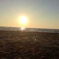 Photo taken at Divjak beach by Ana V. on 7/25/2013