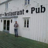 Photo taken at Skjærbrygga Restaurant og rorbuer by Ugur K. on 6/7/2013
