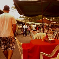 Photo taken at Feira Livre by Sergio E. on 10/25/2012