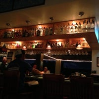 Photo taken at Lei Lei's Bar and Grill by R L. on 10/7/2012