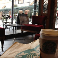 Photo taken at Starbucks by Manu Q. on 10/9/2012