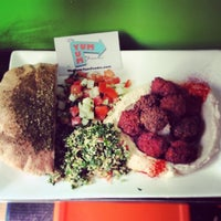 Photo taken at Taïm Falafel and Smoothie Bar by TheYumYum F. on 4/23/2014