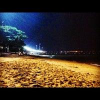 Photo taken at Jomtien Beach by Prae S. on 10/8/2012
