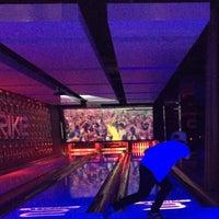 Photo taken at Strike Bowling Bar by Deborah T. on 12/28/2014