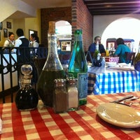 Photo taken at Italianni's Pasta, Pizza & Vino by Alessa on 2/10/2013