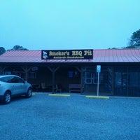Photo taken at Smoker's BBQ Pit by Micah K. on 5/6/2013