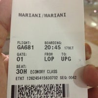 Photo taken at Garuda Indonesia Check In Counter by Mariani V. on 10/17/2013