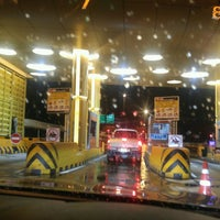 Photo taken at Anusorn Sathan Toll Plaza 1/2 by Tha T. on 9/20/2016