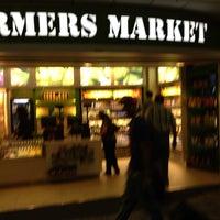 Photo taken at Charlotte Regional Farmer's Market by Nick G. on 7/11/2013