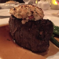 Photo taken at Russell's Steaks, Chops, & More by Patrick H. on 4/8/2015
