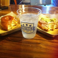 Photo taken at DISTRICT. Donuts. Sliders. Brew. by Monica R. H. on 12/29/2013