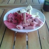 Photo taken at Bartola Restaurant € Coffee Bar by Arthur R. on 12/21/2012