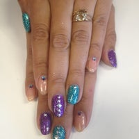 Photo taken at Love Your Nails Spa by Merna Z. on 7/17/2013