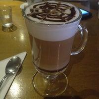Photo taken at Urbe Café Bar by Larissa M. on 3/22/2013