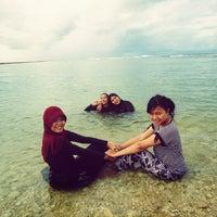 Photo taken at Pantai Ujung Genteng by Gasanova Aida F. on 1/10/2014