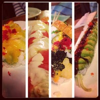 Photo taken at Sushi Park by Rica C. on 5/25/2013