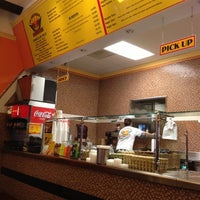 Photo taken at La Victoria Taqueria by Charmayne C. on 12/7/2012