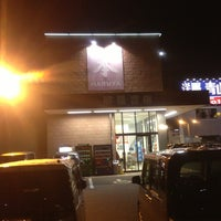 Photo taken at 明屋書店 わさだ店 by Tomohiko K. on 1/19/2013