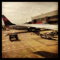 Photo taken at Gate T4 by Christina W. on 12/27/2012