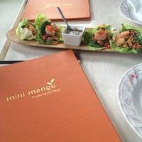 Photo taken at Mini Mango Thai bistro (New name: Mango on main) by Andrea S. on 8/6/2014