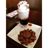 Photo taken at Café Donuts by Ramon A. on 3/27/2015