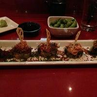 Photo taken at RA Sushi Bar Restaurant by Chris H. on 5/16/2013