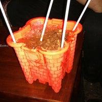 Photo taken at Bad Juju Tiki Bar by Sarah W. on 10/13/2012
