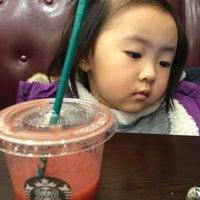 Photo taken at Starbucks by Yongho L. on 1/1/2015