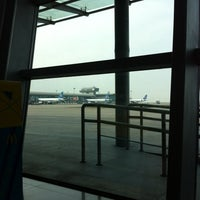 Photo taken at Gate 74 by Yongho L. on 10/13/2013