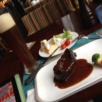 Photo taken at SuperSteak 超级牛扒 by Adil A. on 9/4/2014