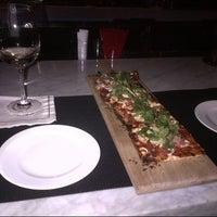 Photo taken at Delmonico's Kitchen by Marcia R. on 2/14/2013