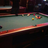 Photo taken at Taps and Dolls by Logan B. on 12/4/2012