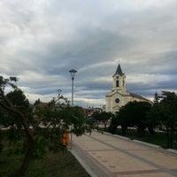 Photo taken at Plaza de Armas de Puerto Natales by Rolinga S. on 2/5/2013