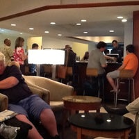 Photo taken at Delta Sky Club by Christie K. on 6/2/2013