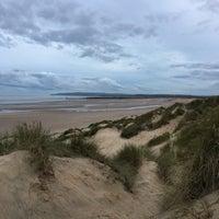Photo taken at Camber Sands Beach by Vortex on 10/7/2017