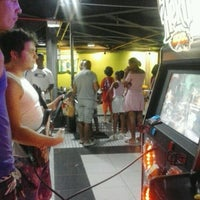 Photo taken at Game Station by Isis A. on 12/23/2012