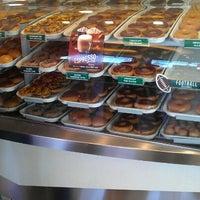 Photo taken at Krispy Kreme Doughnuts by Melissa W. on 11/10/2012