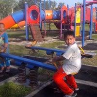 Photo taken at Taman Bermain Puterajaya by Abu-Umar N. on 1/29/2013