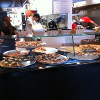 Photo taken at Dom's N.Y. Style Pizzeria by John S. on 9/26/2012