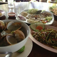 Photo taken at ร้านอาหารต้นปอ by Sui L. on 5/24/2013