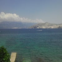 Photo taken at Baška Beach by Nandino L. on 6/23/2013