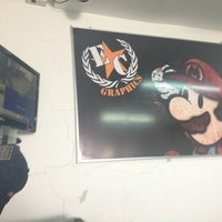 Photo taken at Evolution Car Graphics by Camilo R. on 8/12/2013
