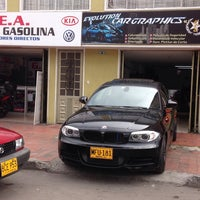 Photo taken at Evolution Car Graphics by Camilo R. on 7/10/2013