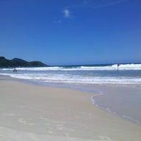 Photo taken at Praia do Mariscal by Christian B. on 2/24/2013