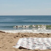 Photo taken at 59th St Beach by Rob B. on 7/15/2013